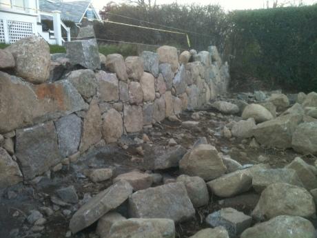 A wall rises
